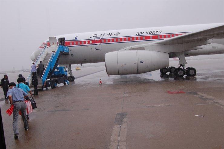 An Air Koryo plane sits on the tarmac at Shenyang Taoxian International Airport, waiting to take us to Pyongyang, in August 2010. / Courtesy of Jon Dunbar