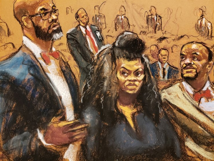 Lawyer Jason Foy speaking next to Tova Noel and lawyer Montell Figgins as Michael Thomas (not pictured) and Noel appear on charges they falsely certified to having conducted inmate counts during Jeffrey Epstein's final hours at the Federal Court in New York City, New York, U.S., November 19, 2019 in this courtroom sketch. Reuters