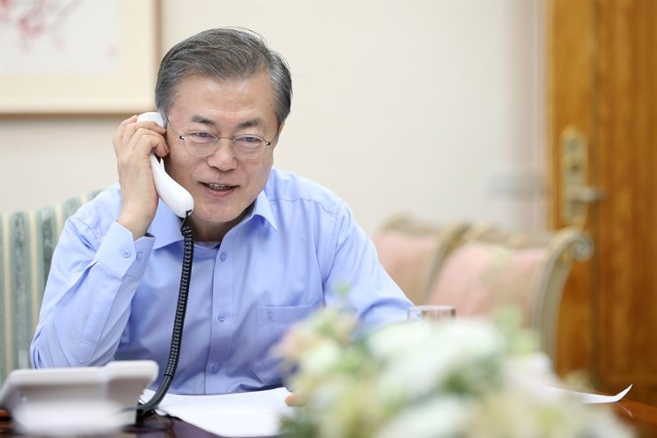 President Moon Jae-in talks on the phone on Jan. 1. Courtesy of Cheong Wa Dae
