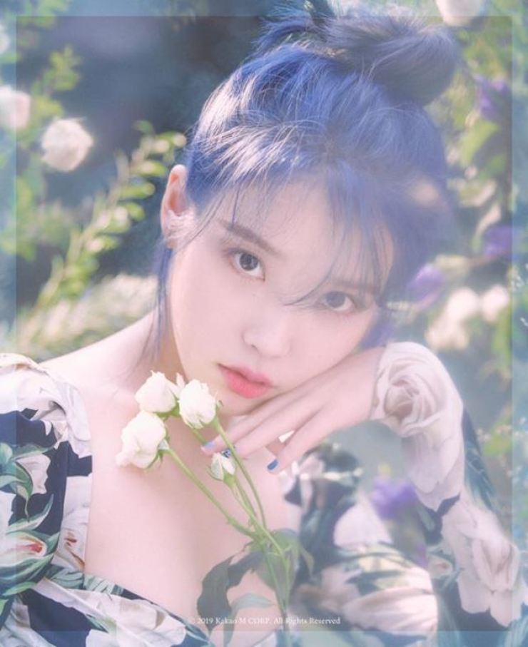 IU will release her fifth mini-album 'Love Poem' on Nov. 18. Courtesy of Kakao M