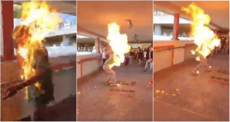 A Hong Kong man was set on fire by one of the protesters who were vandalizing facilities at Ma On Shan MTR station on Sai Sha Road in Ma On Shan, Nov. 11. Screen capture from Twitter