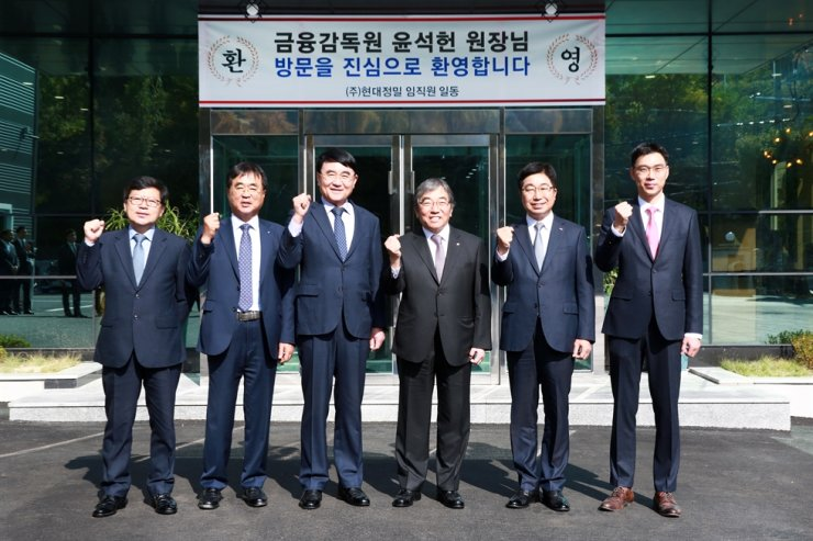 Financial Supervisory Service (FSS) Governor Yoon Suk-heun, third from right, poses with executives of Hyundai Minuteness at the firm's headquarters in Changwon, South Gyeongsang Province, Thursday. He visited the manufacturer of heavy equipment components to examine how Japan's export curbs against Korea influenced small- and medium-sized enterprises in the southeastern region. / Courtesy of FSS