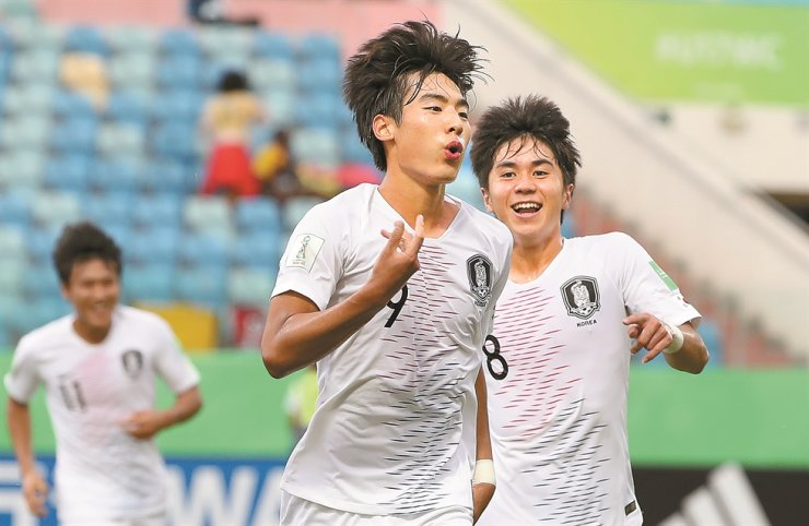 Choi Min-seo celebrates after scoring a goal during the game against Angola in the FIFA U-17 World Cup round of 16 match held in Brazil, Tuesday. /Yonhap