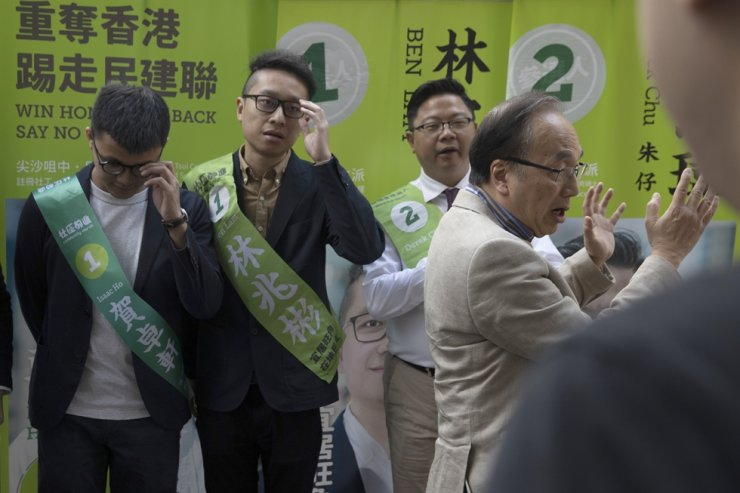 Alan Leong Kah Kit, right, head of the Civic Party, speaks during the party's candidates for the upcoming district councillor election outside a mall in Hong Kong Saturday, Nov. 23, 2019. AP-Yonhap