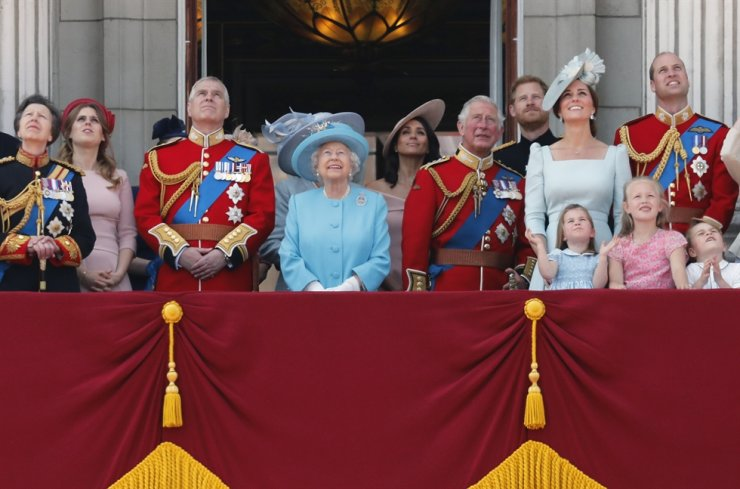 In this Saturday, June 9, 2018 file photo, from left, Britain's Princess Anne, Princess Beatrice, Prince Andrew, Queen Elizabeth, Meghan Duchess of Sussex, Prince Charles, Prince Harry, Kate Duchess of Cambridge and Prince William attend the annual Trooping the Colour Ceremony in London. Prince Andrew said Wednesday Nov. 20, 2019, that he is stepping back from public duties with the queen's permission, saying that recent disclosures regarding his association with the late convicted sex offender Jeffrey Epstein have become a 'major distraction' to the royal family's work. AP