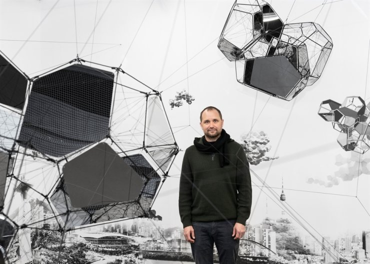 Argentinian-born artist Tomas Saraceno poses for a photo in front of 'Seoul/Cloud Cities' at Gallery Hyundai in central Seoul where his solo exhibition is held through Dec. 8. Courtesy of the artist and Gallery Hyundai