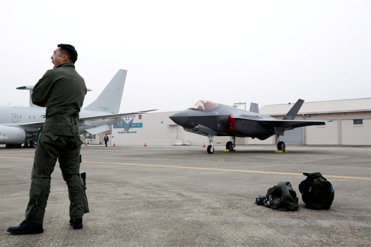 A South Korean pilot stands near his F-35 stealth fighter during a ceremony to mark the 71st Armed Forces Day, at the Air Force Base in Daegu, Oct. 1. Reuters-Yonhap