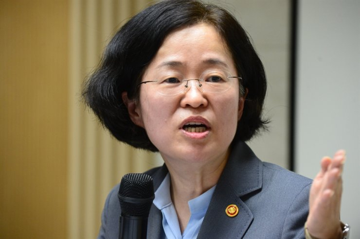 Joh Sung-wook, chairwoman of the Fair Trade Commission, speaks during a press conference about approvals of the proposed acquisitions between LG Uplus and CJ Hello and between SK Broadband and t-broad at the Korea Fair Trade Mediation Agency in Seoul, Friday. / Courtesy of FTC