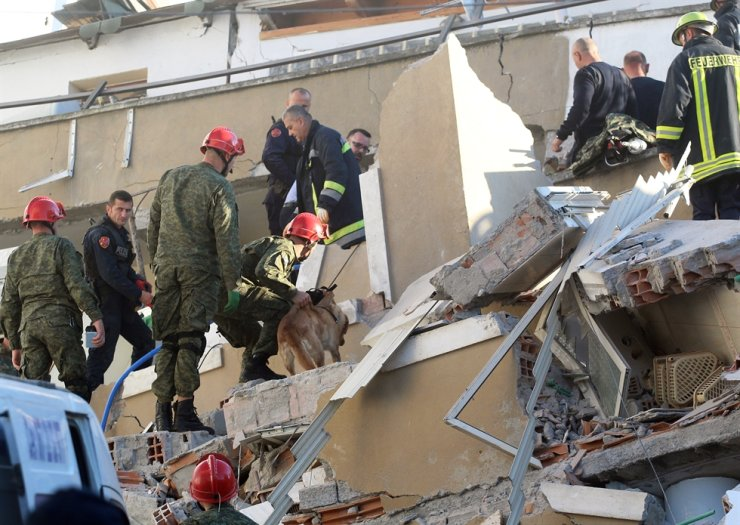 Rescue teams of firemen, army and police search for survivors in the rubble of a collapsed building after an earthquake in Durres, Albania, 26 November 2019. EPA