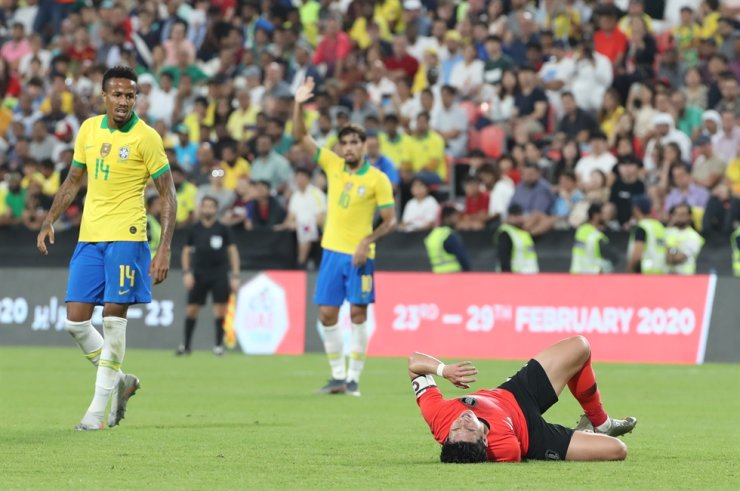 South Korean captain Son Heung-min suffers after a body contact with Brazilian defense during a friendly match at Mohammed Bin Zayed Stadium in Abu Dhabi, the United Arab Emirates, Nov. 19. Yonhap
