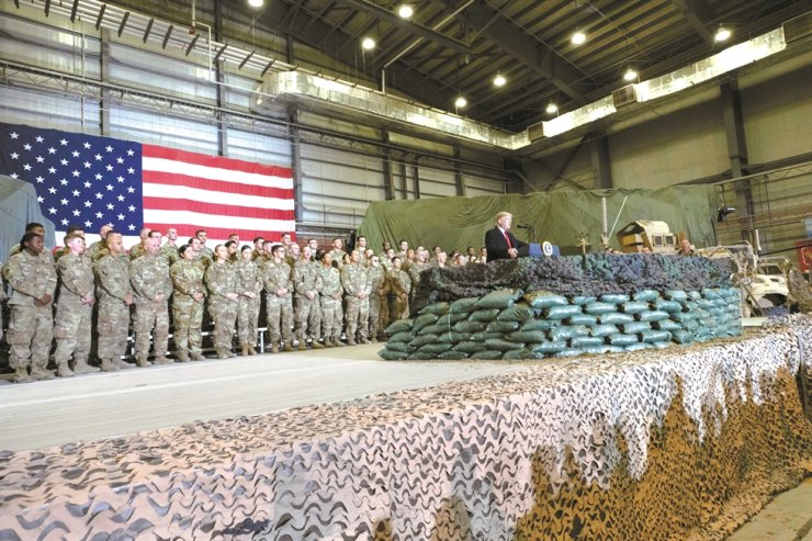 President Donald Trump addresses members of the military during a surprise Thanksgiving Day visit, Thursday, Nov. 28, 2019, at Bagram Air Field, Afghanistan. AP