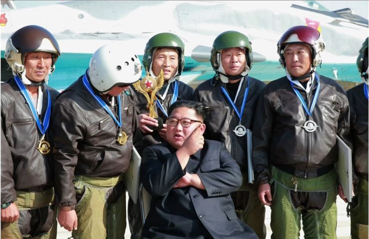 North Korea's Korea Central News Agency reported Saturday that leader Kim Jong-un had watched a military air show at Wonsan Kalma Airport. In this photo, Kim is talking with the pilots who participated in the event. Yonhap