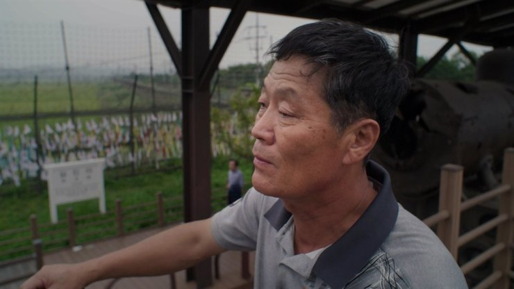 North Korean defector identified only by his surname Park looks out in this still photo of 'Dollar Heroes.' Park, who now lives in South Korea, was a former North Korean guest worker in Russia and he worked as a lumberjack there in the 1980s. / Photo from Sebastian Weis