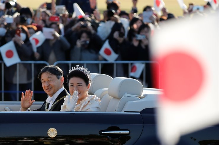 Japan's Emperor Naruhito and Empress Masako wave to well-wishers during their royal parade to mark the enthronement of Japanese Emperor Naruhito in Tokyo, Japan November 10, 2019. Reuters