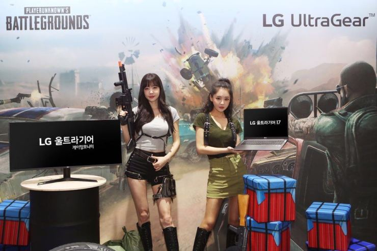 Models pose at the booth installed by LG Electronics at the G-Star global game exhibition that kicked off in the port city of Busan, Thursday. LG said it is exhibiting a variety of devices optimized for games such as monitors and laptops as well as its latest dual-screen V50 ThinQ smartphones. / Courtesy of LG Electronics