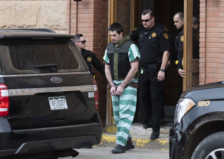 In this April 5, 2019, file photo, Teller County Sheriff deputies lead Patrick Frazee out of the Teller County Courthouse in Cripple Creek, Colo. A jury has convicted Frazee, a Colorado rancher of beating his fiancee to death while their 1-year-old daughter was in a nearby room and then burning the body. AP