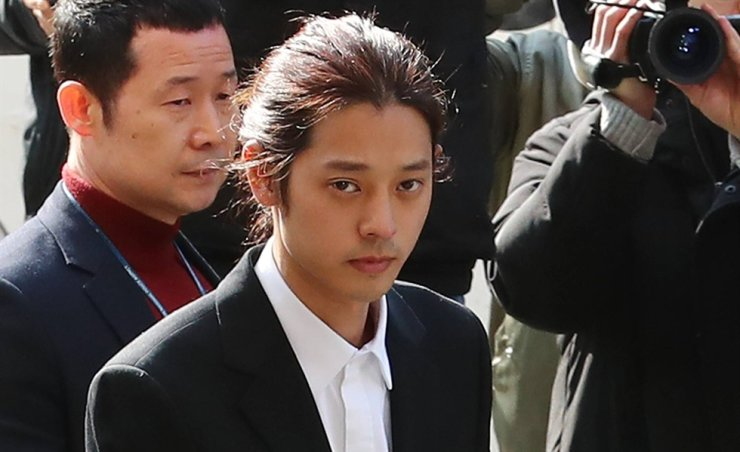 Singer Jung Joon-young enters the Seoul Metropolitan Police Agency to be questioned over gang rape and other sexual violence allegations in this March 14 photo. / Yonhap