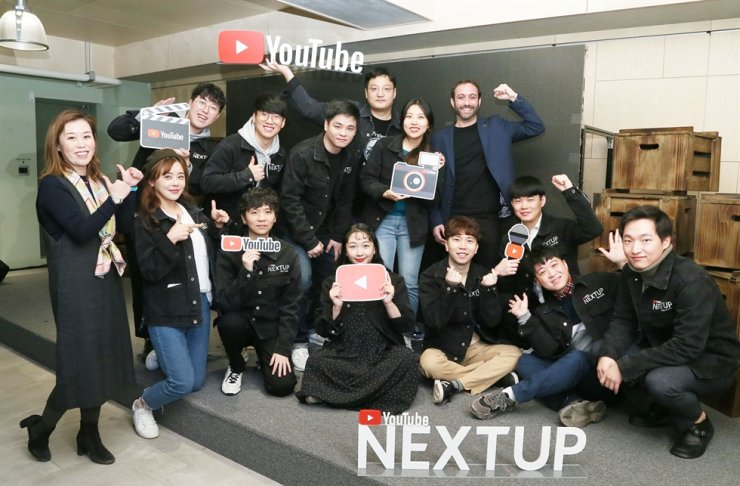 YouTube officials and game content creators who were selected to join YouTube's creator support program, pose during a press conference in Seoul, Wednesday. / Courtesy of YouTube Korea