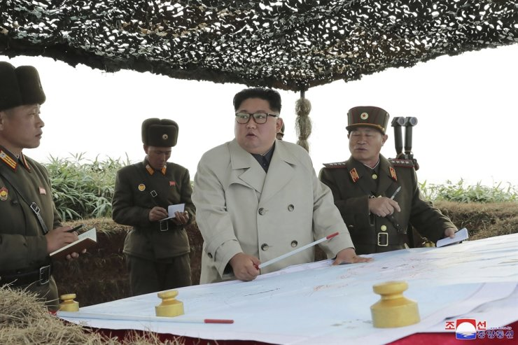 In this undated photo provided on Monday, Nov. 25, 2019, by the North Korean government, North Korean leader Kim Jong-un, center, inspects a military unit on Changrin Islet in North Korea. Korean Central News Agency-AP