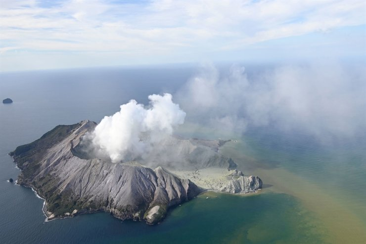 This aerial photo shows White Island after its volcanic eruption in New Zealand Monday, Dec. 9, 2019. The volcano on a small New Zealand island frequented by tourists erupted Monday, and a number of people were missing and injured after the blast. AP