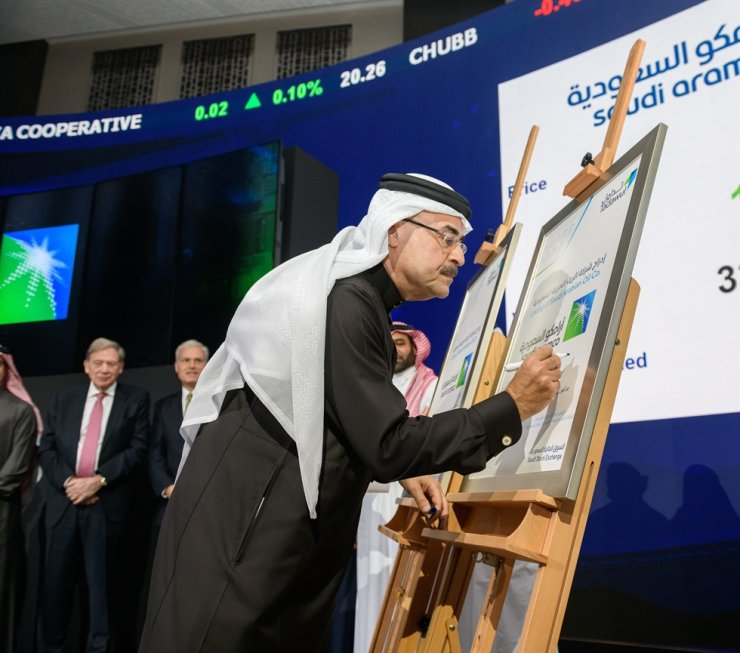 A handout picture provided by Saudi Aramco shows the energey giant's President and CEO Amin Nasser writing a note during the official ceremony launching the debut of Saudi Aramco's initial public offering (IPO) on the Riyadh's stock market, in the Saudi capital Riyadh on December 11, 2019. AFP