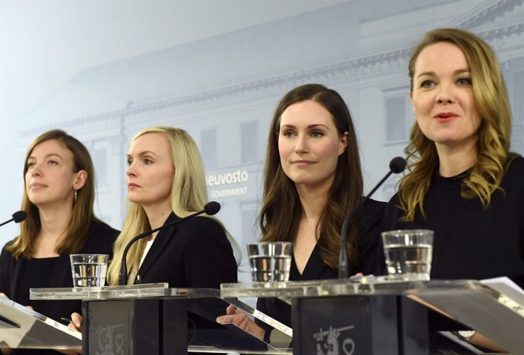 From left, Minister of Education Li Andersson, Minister of Interior Maria Ohisalo, Prime Minister Sanna Marin and Minister of Finance Katri Kulmuni during press conference of the new Finnish government in Helsinki, Finland, on Tuesday. AP