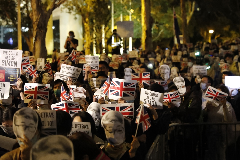 Pro-democracy protesters carry British flags during a rally in support of Simon Cheng, outside of the UK Consulate in Hong Kong, China, Nov. 29, 2019. EPA-Yonhap