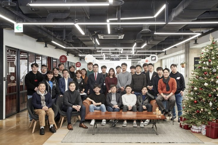 Participants of Hyundai Card's third demo day for startups pose at the event held at the card firm's headquarters on Yeouido, Seoul, Dec. 18. / Courtesy of Hyundai Card