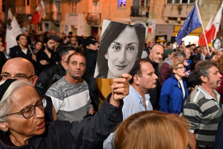 People hold placards and photos of murdered journalist Daphne Caruana Galizia during a protest called for by her family and civic groups Dec. 3, outside police headquarters in Valletta. The scandal-dogged investigation into the murder of the investigative reporter has damaged relations between Malta and the EU, the head of a European Parliament fact-finding delegation said Dec. 3. The urgent mission of seven MEPs to the Mediterranean island follows an escalation in the murder case and Prime Minister Joseph Muscat's decision to resign over what critics have called a botched investigation. AFP