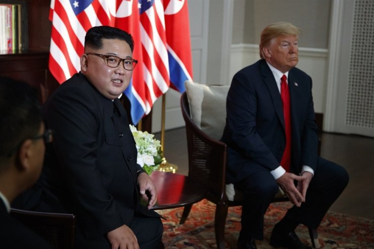U.S. President Donald Trump meets with North Korean leader Kim Jong Un on Sentosa Island, Tuesday, June 12, 2018, in Singapore. (AP Photo/Evan Vucci)