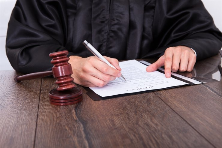 A judge has been suspended for two months after having an affair and hurting his wife who questioned his faithfulness. Gettyimagesbank