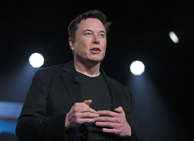In this March 14, 2019, file photo, Tesla CEO Elon Musk speaks before unveiling the Model Y at Tesla's design studio in Hawthorne, Calif. AP