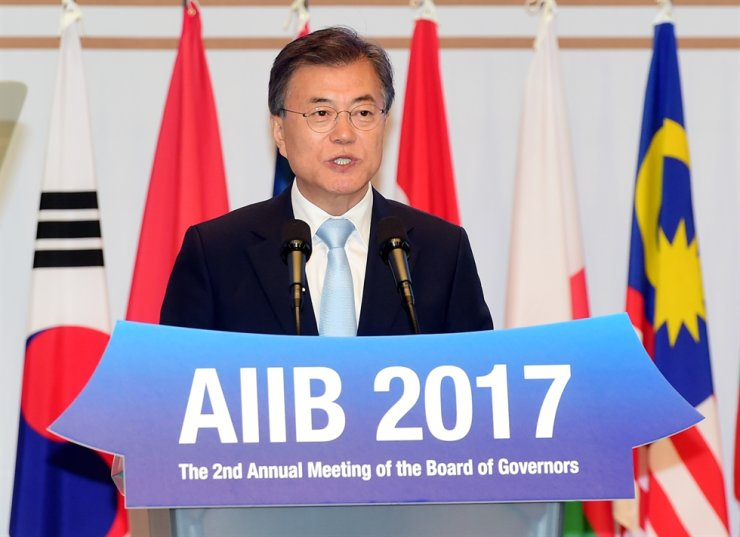 President Moon Jae-in delivers a speech during the annual meeting of the Asia Infrastructure Investment Bank's board of governors on Jeju Island in this June 2017 file photo. / Joint press corps
