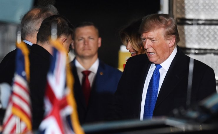 US President Donald J. Trump disembarks from Air Force One upon arrival for a NATO Summit, at Stansted Airport in London, Britain, 02 December 2019. EPA
