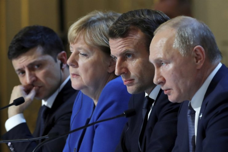 Ukraine's President Volodymyr Zelenskiy, left, German Chancellor Angela Merkel, French President Emmanuel Macron, third left and Russian President Vladimir Putin, right, attend a joint news conference at the Elysee Palace in Paris, Monday Dec. 9, 2019. AP