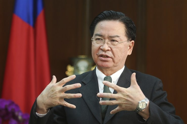 Taiwanese Foreign Minister Joseph Wu gestures while speaking during an exclusive interview with The Associated Press at his ministry in Taipei, Taiwan, Tuesday, Dec. 10, 2019. AP