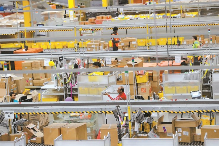 Amazon workers perform their jobs inside of an Amazon fulfillment center on Cyber Monday in Robbinsville, New Jersey, U.S., December 2, 2019. Reuters