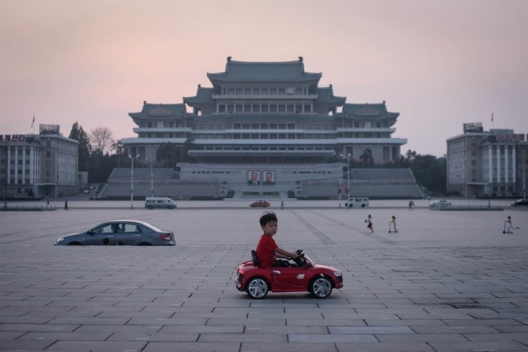 In a photo taken on September 9, 2019, a child drives a miniature electric toy car across Kim Il Sung square in Pyongyang. AFP