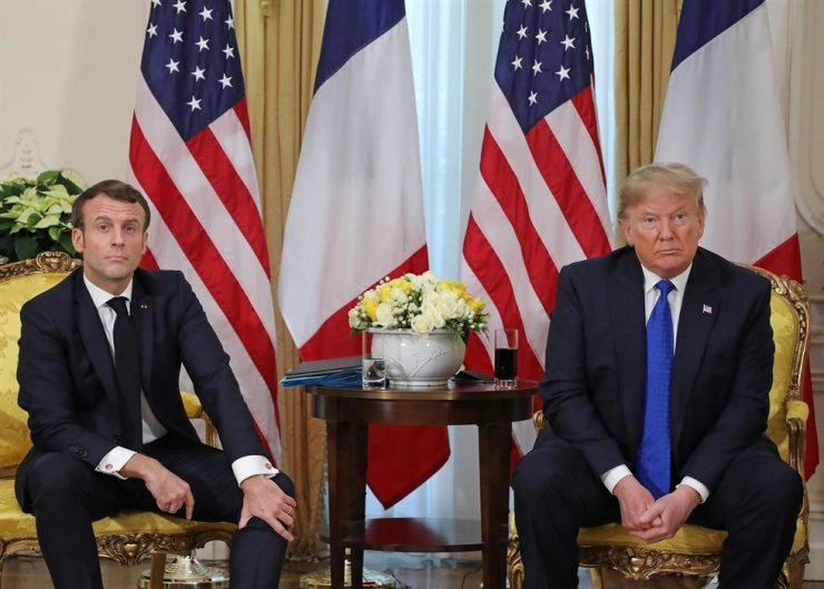 US President Donald Trump (R) and France's President Emmanuel Macron react as they talk during their meeting at Winfield House, London on December 3, 2019. AFP