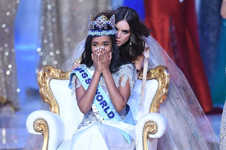 Miss World 2019 Miss Jamaica Toni-Ann Singh reacts after being crowned by Miss World 2018, Mexico's Vanessa Ponce de Leon, during the Miss World Final 2019 at the Excel arena in east London on Dec. 14, 2019. AFP