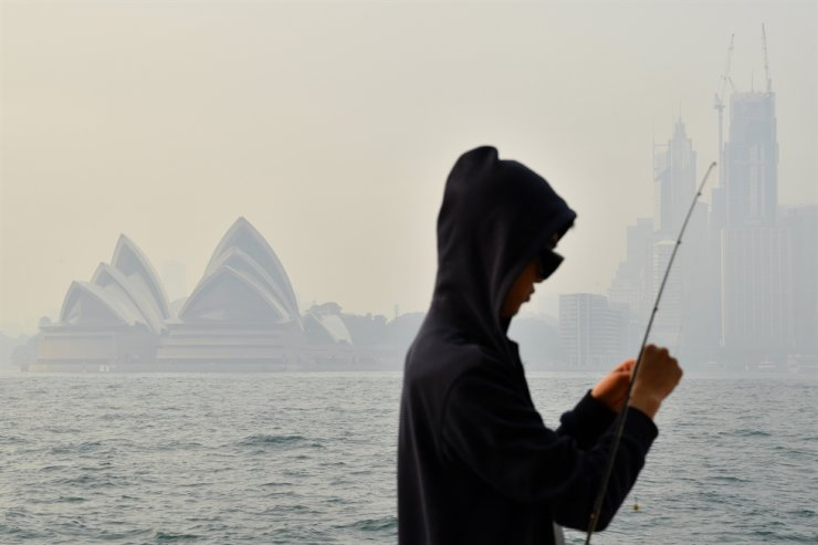 The Sydney Opera House seen as smoke haze from bushfires in New South Wales blankets the Central Business District in Sydney, Australia, Dec. 10. EPA