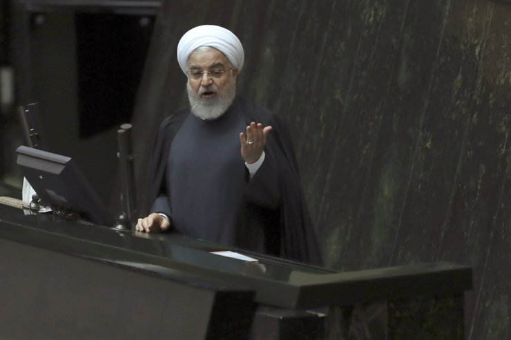 Iranian President Hassan Rouhani speaks while submitting next year's budget bill to the parliament in Tehran, Iran, Dec. 8/ AP-Yonhap