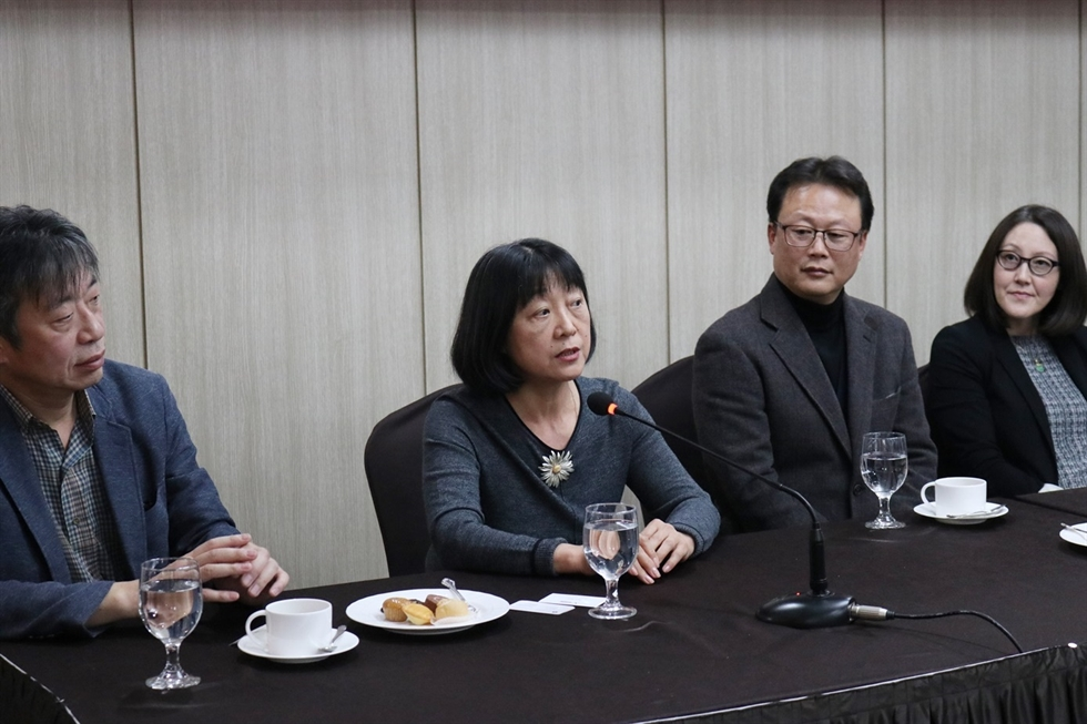 From left, translators Kim Hwan, Li San-lun, author Kim Un-su, translators Sora Kim-Russell, Yoon Sun-me, and author and publisher Pio E. Serrano attend a press conference held in central Seoul, Monday. / Courtesy of LTI Korea