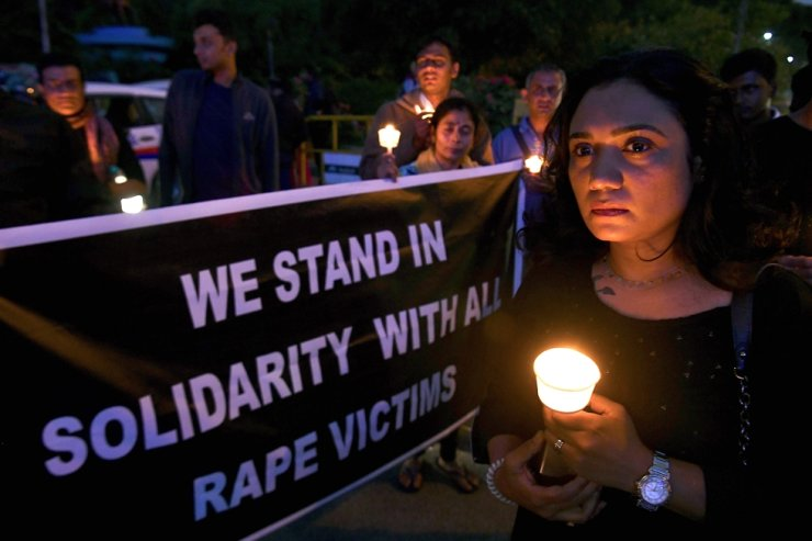 People hold a candlelight vigil in support of sexual assault victims and against the alleged rape and murder of a 27-year-old veterinary doctor in Hyderabad, in Bangalore on Dec. 6, 2019. Another alleged rape victim in northern India set on fire on her way to a court hearing in the case she filed has died. AFP