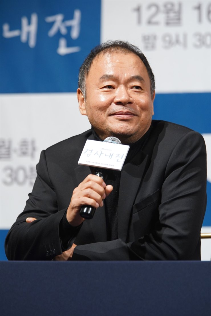 Director Lee Tae-gon answers questions at a press conference for his new television show 'Diary of a Prosecutor' held at the Imperial Palace in Seoul. /Courtesy of JTBC