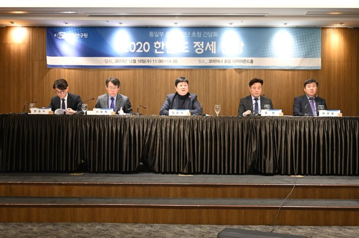 Korea Institute for National Unification researcher Kim Gap-sik, center, speaks during the institute's year-end media conference at the Koreana Hotel in central Seoul, Wednesday. / Courtesy of Korea Institute for National Unification