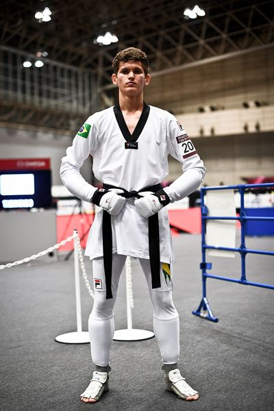 Competitors wearing the new uniform compete during the test event at Makuhari Messe Hall in Chiba, Japan, Sept. 27. World Taekwondo (WT) announced Sunday (KST) that it adopted the uniform for next year's Tokyo Olympics. Courtesy of WT