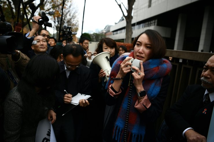 Japanese journalist Shiori Ito speaks to reporters outside the Tokyo district court on December 18, 2019 after hearing the ruling on a damages lawsuit by her, accusing a former TV reporter of rape. AFP