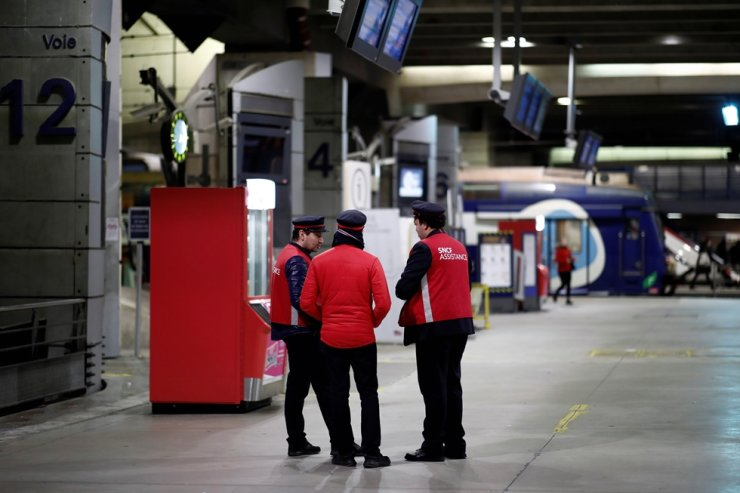 Employees of French national railway operator SNCF are seen on a platform at Gare Montparnasse train station during a strike by all unions of French SNCF and the Paris transport network (RATP) in Paris as French transportation workers' strike continues for a 23rd day against pension reform plans in France, December 27, 2019. Reuters