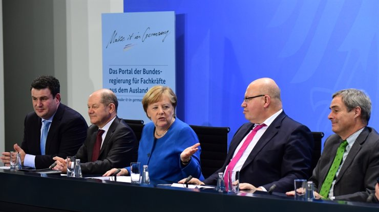 German Minister of Labor and Social Affairs Hubertus Heil, from left to right, German Minister of Finance Olaf Scholz, German Chancellor Angela Merkel, German Minister of Economy and Energy Peter Altmaier and Confederation of German Employers? Associations (BDA) President Ingo Kramer during the press conference after a top-level talk on skilled workers immigration law at the chancellery in Berlin, Germany, 16 December 2019. During the top-level talk, representatives of the economy, trade unions and the government, discuss how to put the killed workers immigration law into practice to counteract the lack of specialists. EPA